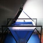 """Bild: Arnold Design Aquarium """"Mecklenburg-Vorpommern"""" (2006) mit geöffneten Beleuchtungsmodul. Als Beleuchtung dienen 2 x 14 T8 Arcadia Freshwater Leuchtstoffröhren. Experience The Perfection, Experience The Beauty."""