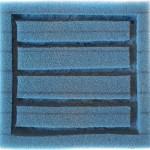 Bild: Garnelenzucht / Die Rückseite eines Hamburger Mattenfilters in den nachträglich Kanäle geschnitten wurden um die biologische Oberfläche zu erhöhen.