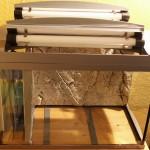 Bild: Licht und Filtertuning / Tetra AquaArt Aquarium (2010) Die Funktion der Luken ist nur unwesentlich eingeschränkt.
